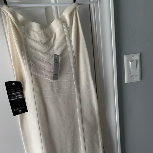 bebe Dresses & Skirts - Bebe Crisscross Bandage Dress